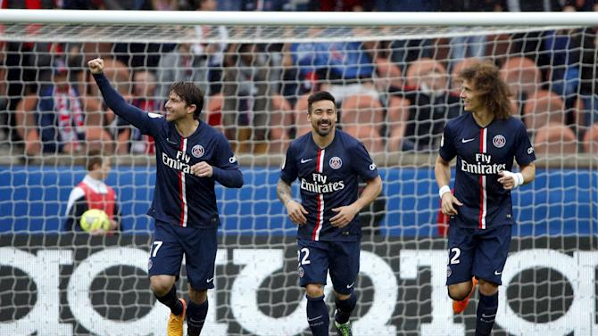 Paris Saint-Germain's Maxwell, Ezequiel Lavezzi and David Luiz celebrate after scoring a goal against Lille during their French Ligue 1 soccer match at Parc des Princes stadium in Paris