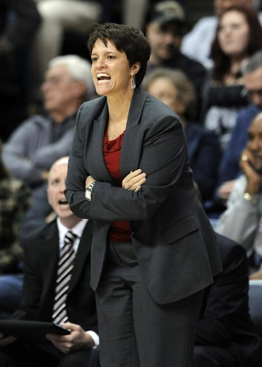 In this Nov. 22, 2013, photo, Boston University women's basketball coach Kelly Greenberg calls out during a game against Connecticut in Hartford, Conn. Greenberg resigned Wednesday, April 23, 2014
