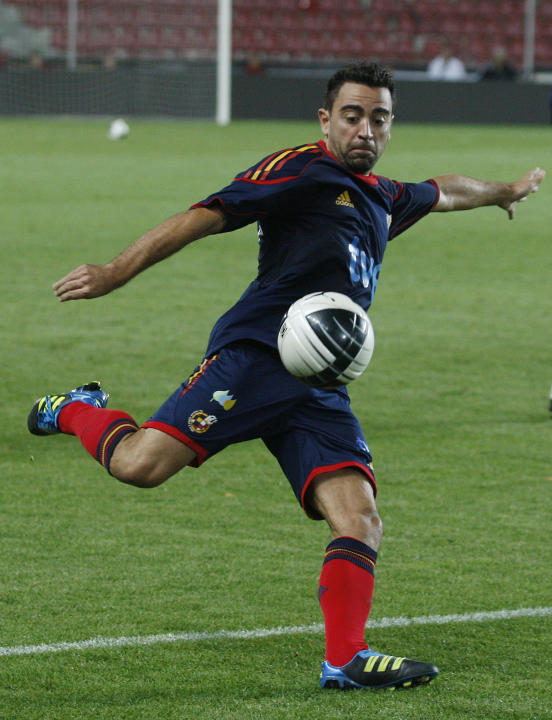 Spain's Xavi Hernandez kicks a ball during a practice session prior the Euro 2012 Group I qualifying soccer match in Prague, Czech Republic, Thursday, Oct. 6, 2011. Czech Repubic faces spain on Friday