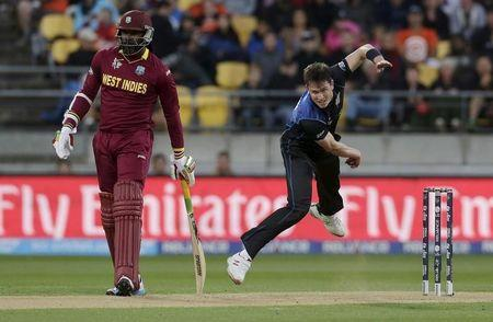 West Indies' Gayle watches as New Zealand's Milne bowls in their Cricket World Cup quarterfinal match in Wellington