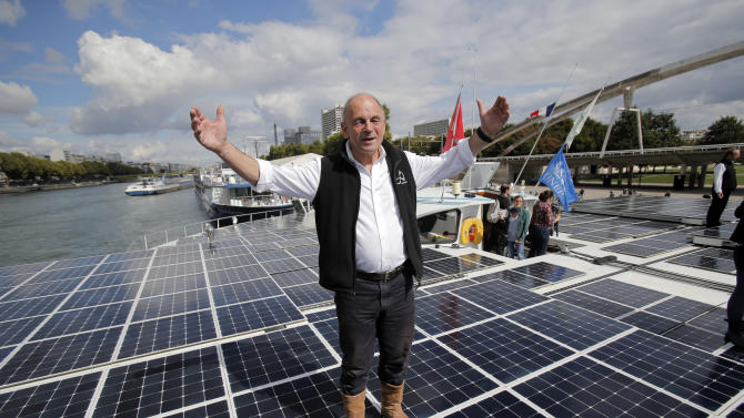 French skipper Gerard d'Aboville and captain of The Turanor PlanetSolar, poses on the world's largest solar boat, in Paris, Tuesday, Sept. 10, 2013. The PlanetSolar with its 537 square meters of photovoltaic panels powering 6 blocks of lithium-ion batteries, accomplished the first around the world trip powered only by solar energy in May 2012. (AP Photo/Christophe Ena)