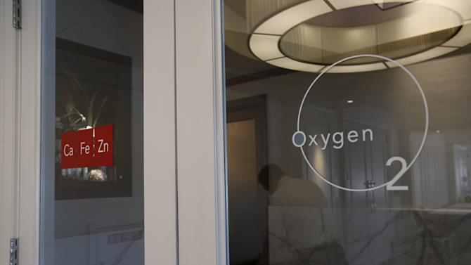 The logos to the French styled bistro 'Cafe Zinc' and the 'Bar Oxygen 02' are seen on the doors at the H Hotel in Midland, Michigan