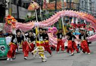 Members of the Chinese community perform a typical dragon dance to celebrate the Chinese New Year in the streets of Manila in 2009. Philippine President Benigno Aquino Thursday declared Chinese New Year an official holiday, ignoring the objections of some in the business community who say there are already too many public holidays