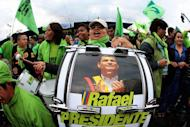 Supporters of Ecuadorian President Rafael Correa celebrate his re-election in Quito on February 17, 2013. Correa's popular social programs have won him support across the geographically diverse nation