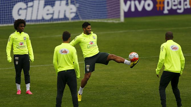 Brazil's player Hulk controls the ball during a team training session at Santiago