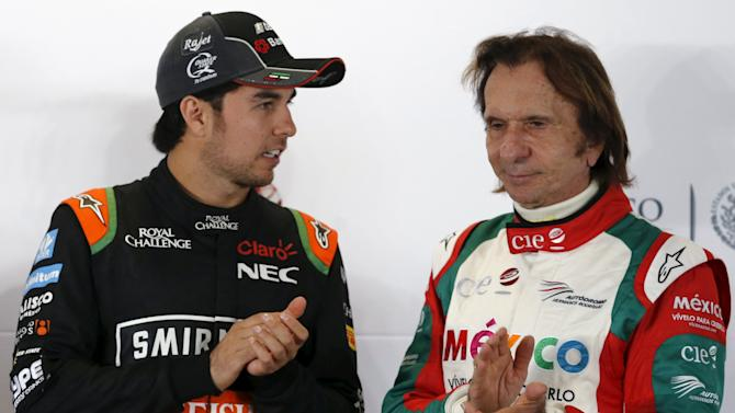 Former Brazilian Formula One driver Fittipaldi applauds with Force India Formula One driver Perez of Mexico after they attended a news conference in Mexico City