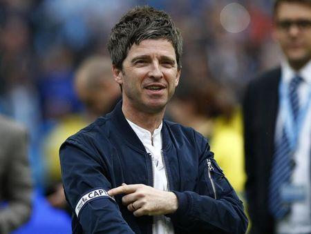 Noel Gallagher singer and Manchester City fan shows off the captains' arm band, given to him by Vincent Kompany,  following their soccer match against West Ham United at the Etihad Stadium in Manc