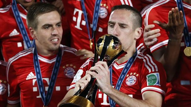 Germany's Bayern Munich Franck Ribery kisses the trophy as he celebrates with his team mates after winning their 2013 FIFA Club World Cup final soccer match against Morocco's Raja Casablanca at Marrakech stadium December 21, 2013 (Reuters)