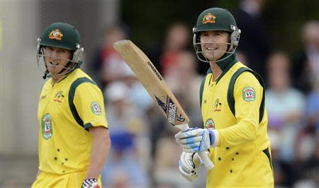 Australia's Clarke waves his bat after reaching his half century as Bailey looks on during the second one-day international against England at Old Trafford cricket ground in Manchester