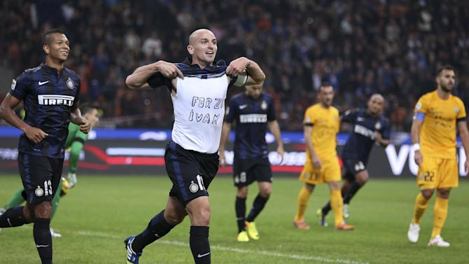"""Inter Milan Argentine midfielder Esteban Cambiasso celebrates after scoring during the Serie A soccer match between Inter Milan and Hellas Verona at the San Siro stadium in Milan, Italy, Saturday, Oct. 26, 2013. The writing on the shirt """"Forza Ivan"""" (Go Ivan) is a get well wish for his teammate Ivan Cordoba, recently hospitalized"""