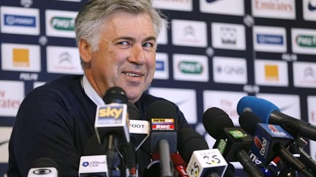 "Paris Saint-Germain's Italian coach Carlo Ancelotti smiles during a press conference at the club's training center ""le camp des loges"" on May 11, 2013 (AFP)"