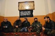 "Syrian rebels rest in their compound in Aleppo's old city on January 16, 2013. More than 100 civilians have been killed in a new ""massacre"" in Syria, a watchdog said Thursday, as Russia slammed the United States for blaming deadly blasts at a university campus on the Damascus regime"