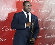 "British film director Steve McQueen of the film ""12 Years A Slave"" poses after wining Director of the Year at the 2014 Palm Springs International Film Festival Awards Gala in Palm Springs, California January 4, 2014. REUTERS/Fred Prouser"