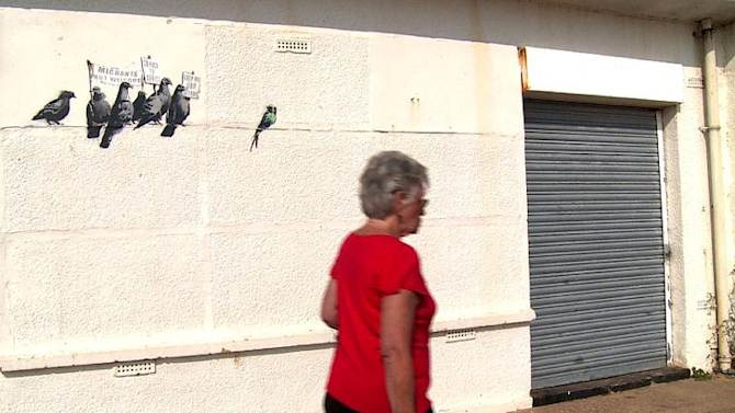 Banksy 39 s 39 offensive 39 mural painted over in british town for Banksy mural painted over