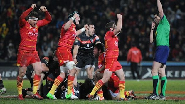 Perpignan players celebrate their 19-18 victory over Toulouse at the Ernest Wallon Stadium (AFP)