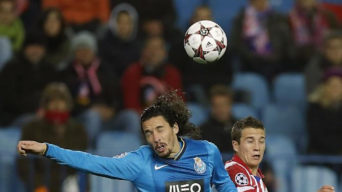 Atletico's Javi Manquillo, right, in action with Porto's Lica, left, during a Champions League Group G soccer match between Atletico Madrid and FC Porto, at the Vicente Calderon stadium in Madrid, Wednesday, Dec. 11, 2013