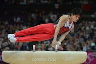 Japan's gymnast Kohei Uchimura competes on the pommel horse during the men's team final of the artistic gymnastics event of the London Olympic Games at the 02 North Greenwich Arena in London