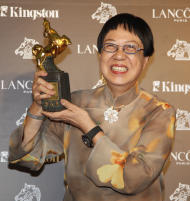 "Hong Kong director Ann Hui holds her award for Best Director at the 48th Golden Horse Awards, Saturday, Nov. 26, 2011, in Hsinchu, northern Taiwan. Ann Hui won for the film "" A Simple Life "" at this year's Golden Horse Awards -the Chinese-language film industry's biggest annual event. (AP Photo/Wally Santana)"