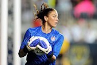 Hope Solo, pictured in May 2012, the starting goalkeeper for the defending champion United States women's Olympic football squad, has been given only a warning after a positive doping test