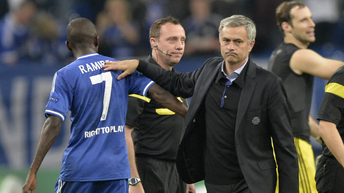 Chelsea's manager Jose Mourinho, right, pats Chelsea's Ramires on the back after winning the Champions League group E soccer match between FC Schalke 04 and Chelsea FC in Gelsenkirchen, Germany, Tuesday, Oct. 22, 2013