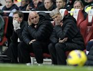 Arsenal manager Arsene Wenger, far right, watches in frustration as his side allowed a two-goal lead to slip for the second time in five days before eventually being forced to settle for a point in a 3-3 home draw with Fulham