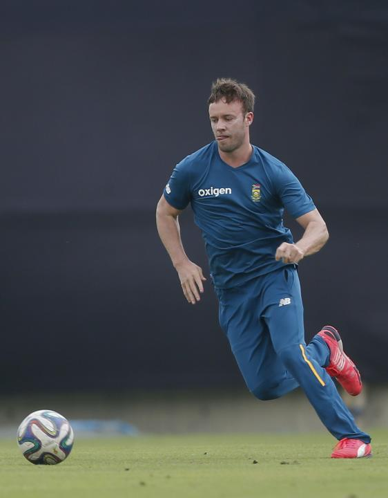 South Africa's AB de Villiers, plays with a soccer ball during a practice session ahead of their first Twenty20 cricket match against Bangladesh in Dhaka, Bangladesh, Wednesday, July 1, 2015. (AP Phot