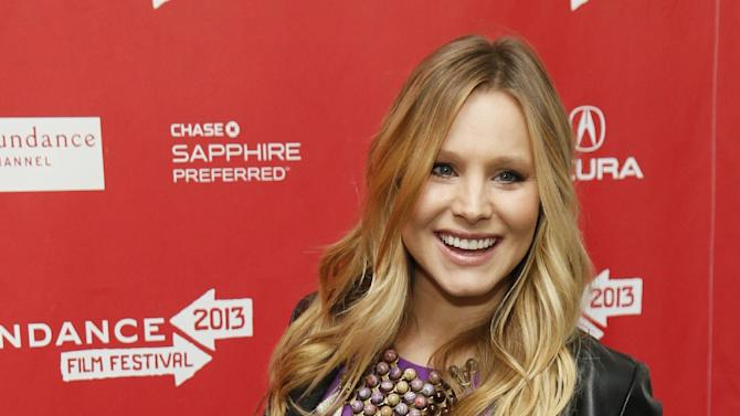 """FILE - This Jan. 19, 2013 file photo shows  pregnant actress Kristen Bell at the premiere of """"The Lifeguard"""" during the 2013 Sundance Film Festival in Park City, Utah.  Fashion experts say a streamlined style best suits a baby bump. (Photo by Danny Moloshok/Invision/AP, file)"""