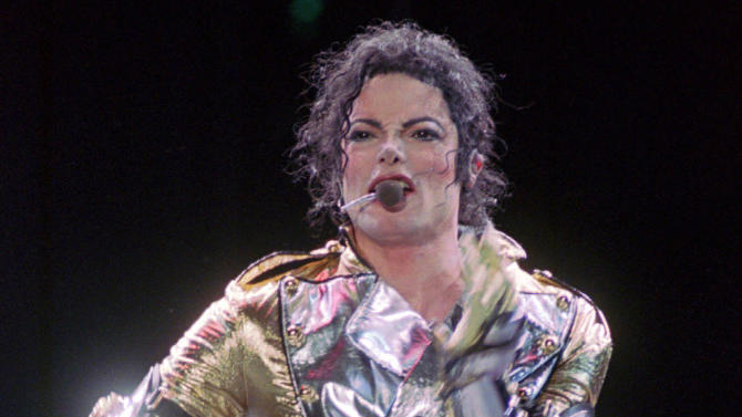 FILE - In this Dec. 8, 1996 file photo, Michael Jackson belts out a song during the first concert of his 2-days concert tour in Manila, dubbed as HIStory World tour. Accounting expert Arthur Erk told a jury on Monday, July 15, 2013, that Jackson would have likely earned at least $1.1 billion if he completed a worldwide tour and crafted a Las Vegas show before dying. Erk's testimony in a lawsuit filed by the singer's mother, Katherine Jackson, against concert promoter AEG Live LLC, includes estimates that Jackson would have spent $134 million before retiring from showbiz at age 65. (AP Photo/Pat Roque, File)