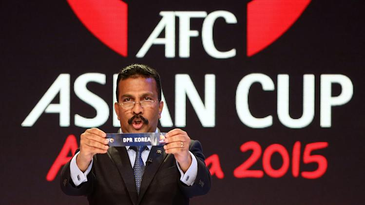 AFC General Secretary Dato' Alex Soosay holds up the name North Korea during the Asian Football Confederation draw for the 2015 Asian Cup at the Sydney Opera House ground in Sydney, Wednesday, March 26, 2014. Australia hosts the tournament that will be played in Jan. 2015