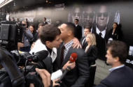 "In this video image taken from AP video U.S. actor Will Smith, center right, is embraced by reporter Vitalii Sediuk, white suit, from the Ukrainian television channel 1+1 on the red carpet before the premiere of ""Men in Black III"" Friday May 18, 2012 in Moscow. Hollywood star Will Smith has slapped a male television reporter who tried to kiss him before the Moscow premiere of ""Men in Black III."" Smith pushed him away and then slapped him lightly across the cheek with the back of his left hand. (AP Photo via AP video)"