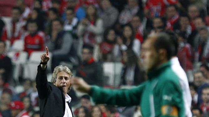 Benfica's coach Jorge Jesus, left, and Sporting's coach Leonardo Jardim, right, give instructions to their players during a Portugal Cup soccer match between Benfica and Sporting at Benfica's Luz stadium in Lisbon, Saturday, Nov. 9, 2013. Benfica won 4-3 in extra time