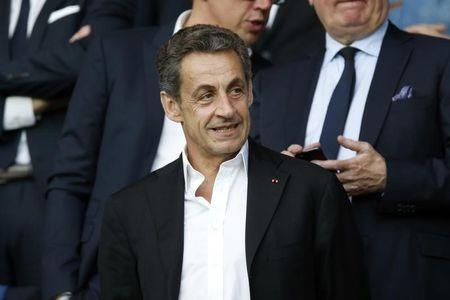 France's former president Nicolas Sarkozy attends the French Ligue 1 soccer match between Paris St Germain and Reims at the Parc des Princes stadium in Paris