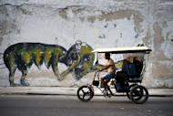 In this Feb. 12, 2017 photo, the work of urban artist Yulier P. adorns a wall on a street in Havana, Cuba. Cuba has long had a thriving art scene and there has in recent years been a boom for works by some of the island's most famous painters. But the 27-year-old artist, whose full name is Yulier Rodríguez Pérez did not emerge from the artistic establishment and the kind of urban art he practices is unusual here. (AP Photo/Ramon Espinosa)