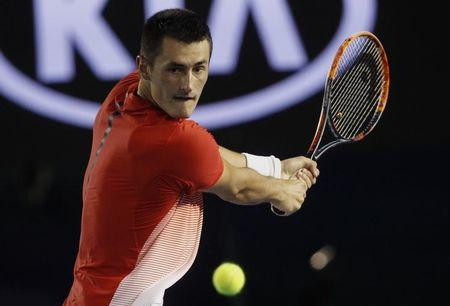 Australia's Tomic hits a shot during his third round match against compatriot Millman at the Australian Open tennis tournament at Melbourne Park