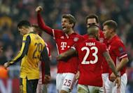Football Soccer - Bayern Munich v Arsenal - UEFA Champions League Round of 16 First Leg - Allianz Arena, Munich, Germany - 15/2/17 Bayern Munich's Thomas Muller celebrates scoring their fifth goal with teammates Reuters / Michaela Rehle Livepic