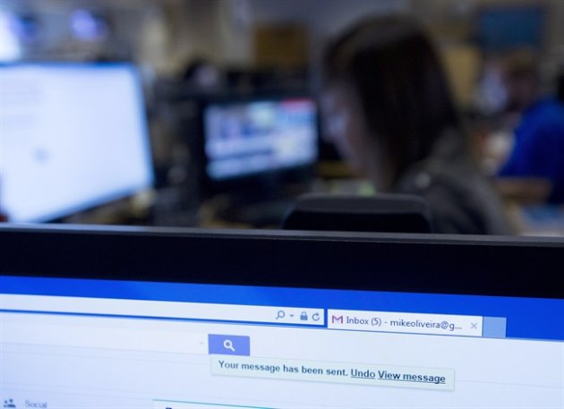 The undo send button is shown on a Gmail account as employees work on their computers in Toronto on Wednesday, June 24, 2015. Gmail has implemented a new feature that allows people to undo a sent email. THE CANADIAN PRESS/Nathan Denette