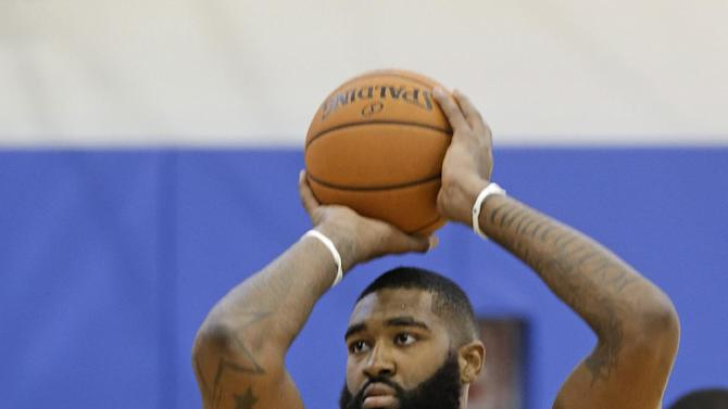 Orlando Magic's Kyle O'Quinn shoots jump shots during practice at NBA basketball training camp, Tuesday, Oct. 1, 2013, in Orlando, Fla