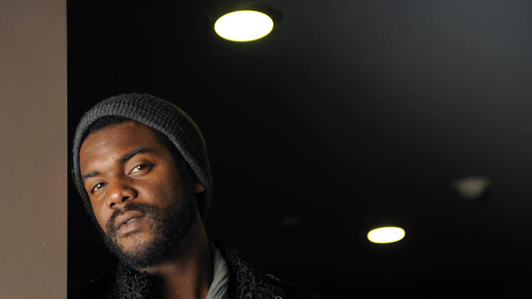 "This Oct. 23, 2012 photo shows guitarist Gary Clark Jr., posing for a portrait at The BLVD Hotel in Los Angeles. Clark's latest album, ""Blak and Blu,"" was released this week.  (Photo by Chris Pizzello/Invision/AP)"