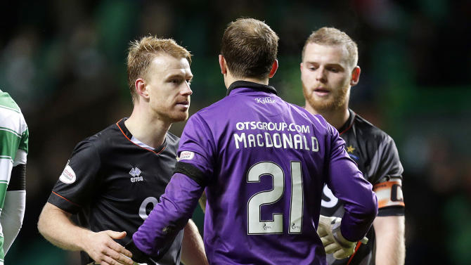 Kilmarnock's Steven Smith (L) and Jamie MacDonald (C) and Mark Connolly (R) celebrates at the end of the game