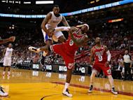 DeAndre Jordan (L) of the Los Angeles Clippers and LeBron James of the Miami Heat fight for a loose ball, on February 8, 2013. James scored 30 points in just 31 minutes to lead NBA champions Miami to a 111-89 victory over the Clippers