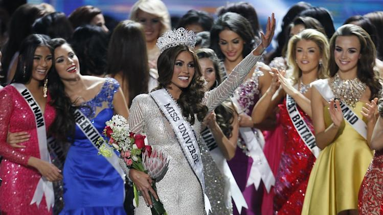 Miss Universe 2013 Gabriela Isler, from Venezuela, center, waves after winning the 2013 Miss Universe pageant in Moscow, Russia, on Saturday, Nov. 9, 2013. (AP Photo/Pavel Golovkin)