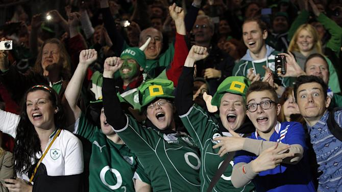 Ireland's Fans celebrate after winning the Six Nations Rugby Union tournament at the stade de France stadium, in Saint Denis, outside Paris, Saturday, March 15, 2014. (AP Photo/Christophe Ena)
