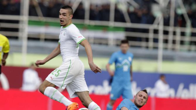 Algeria's Bentaleb fights for the ball with Slovenia's Kurtic during their international friendly soccer match in Algiers