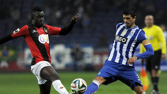 "FC Porto's Lucho Gonzalez, from Argentina, vies Olhanense's Judilson ""Pele"" Gomes, left, in a Portuguese League soccer match at the Dragao Stadium in Porto, Portugal, Friday, Dec. 20, 2013. Porto won 4-0"