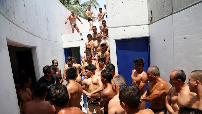 Inmates flex their muscles before a bodybuilding contest at a prison in Atlacholoaya