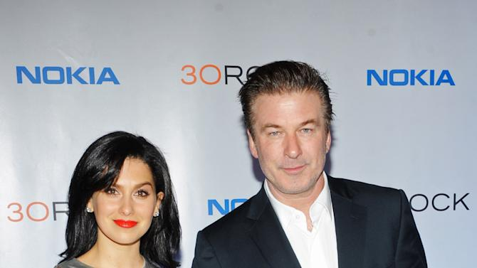 "FILE - This Dec. 20, 2012 file photo released by Nokia shows Hilaria Thomas, left, and actor Alec Baldwin at the Nokia ""30 Rock"" wrap party in New York.            A representative for Alec Baldwin says the ""30 Rock"" star and his wife Hilaria are expecting their first child together. Baldwin, 54, is already the father of a 17-year-old daughter, Ireland, from his previous marriage to actress Kim Basinger. (AP Photo/Nokia, Scott Gries, file)"