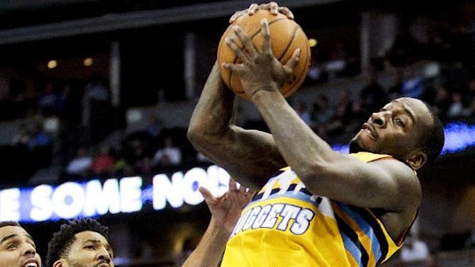Denver Nuggets' J.J. Hickson, right, grabs a rebound against the Oklahoma City Thunder during the third quarter of an NBA basketball game Tuesday, Dec. 17, 2013, in Denver. The Thunder won 105-93