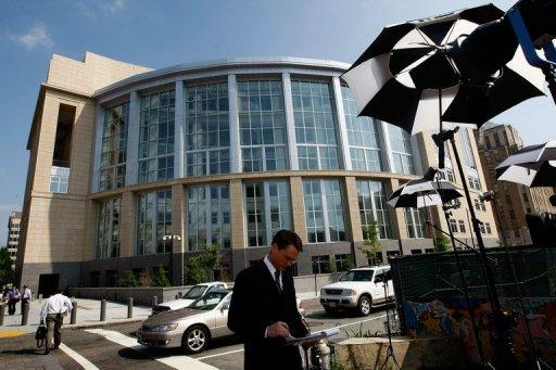 TV crews report outside a federal court in Richmond, Virginia, after Allen Stanford's court appearance on June 19, 2009