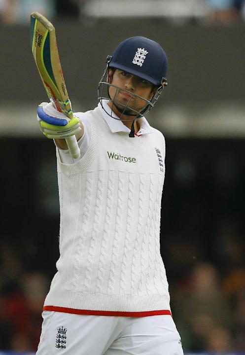 England's Alastair Cook celebrates his century to a standing ovation from the crowd during the fourth day of the first Test match between England and New Zealand at Lord's cricket ground in Lo