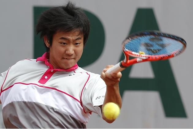 The Latest: Berdych blows away Japanese qualifier at French